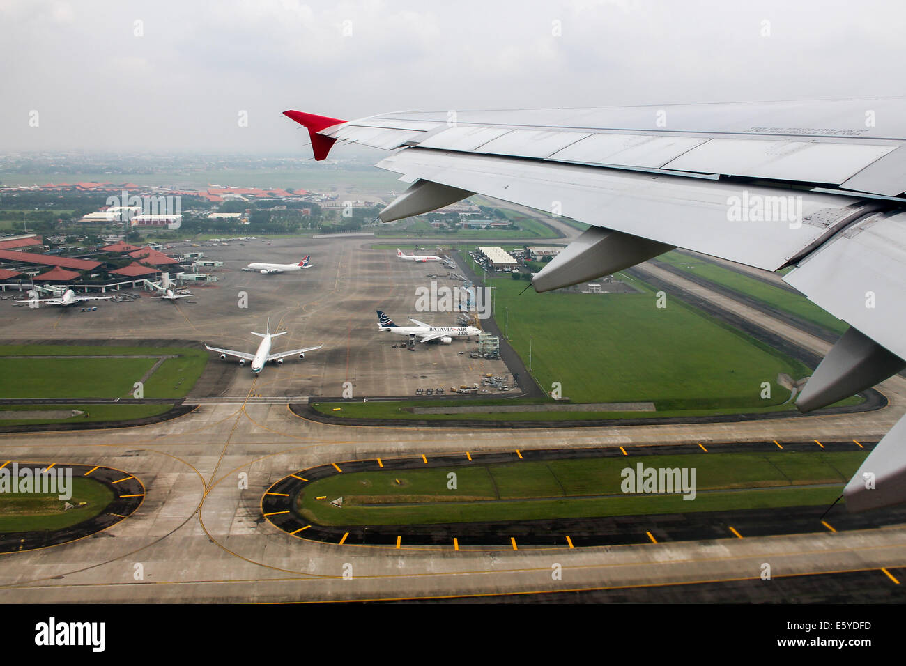 Climbing away from hazy Jakarta, on board Indonesia AirAsia Airbus A320. Stock Photo
