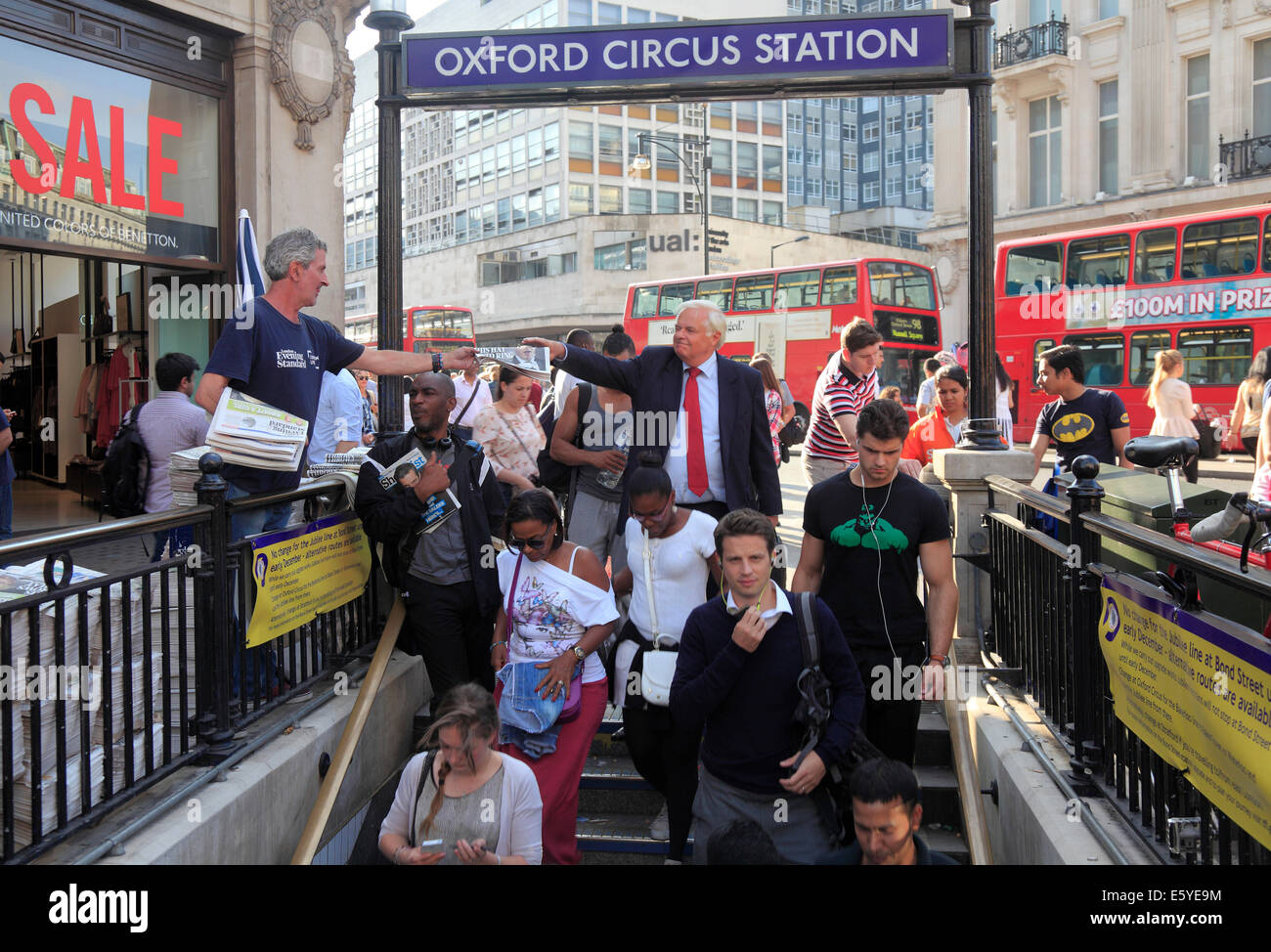 Commuters in Oxford Street London West End buying newspapers