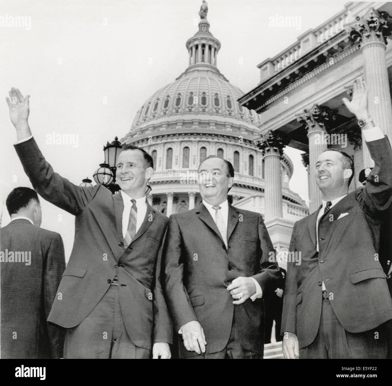 Astronauts Edward White II (L) and James McDivitt (R) with U.S. VP Hubert Humphrey on Steps of Capitol Building, - Stock Image