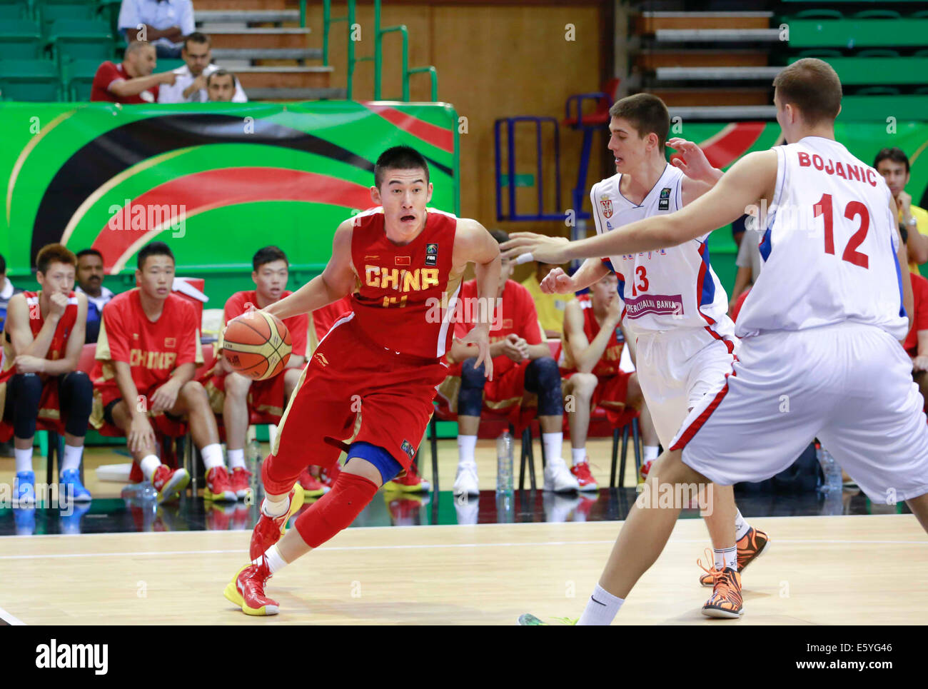 (140809) -- DUBAI, Aug. 9, 2014(Xinhua) -- Fu Hao (L) of China competes during a match between China and Serbia Stock Photo
