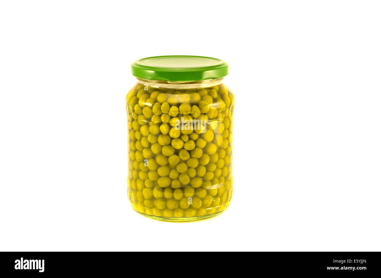 green peas vegetables canned preserved in glass jars pots isolated on white background Stock Photo