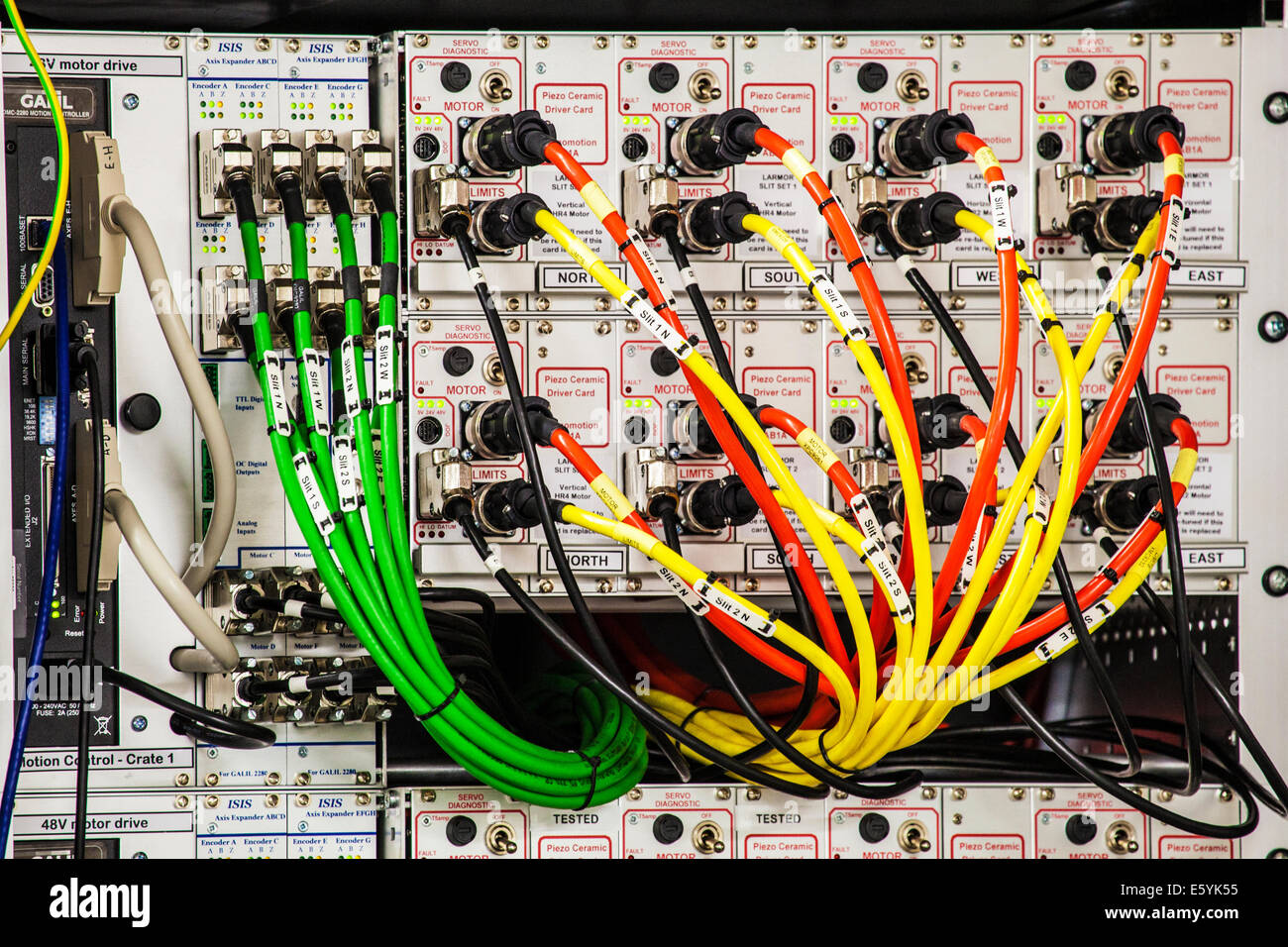 A maze of colour coded electric cables powering scientific equipment in a research laboratory. - Stock Image