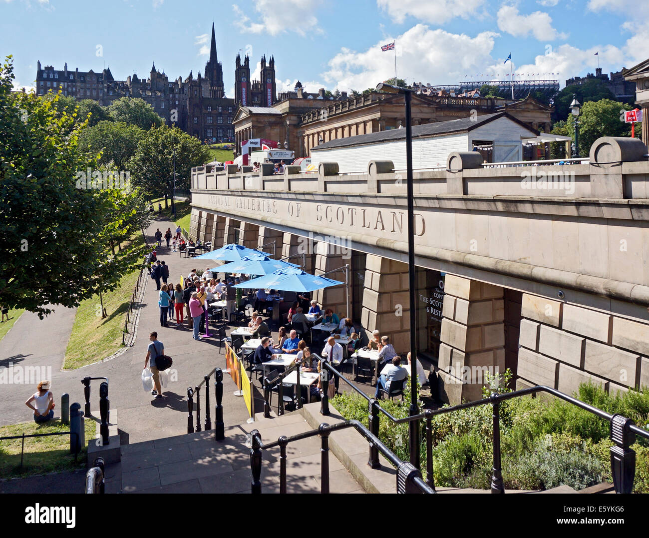 Entrance to the National Galleries of Scotland in Edinburgh with visitors enjoying food and drink at restaurant - Stock Image