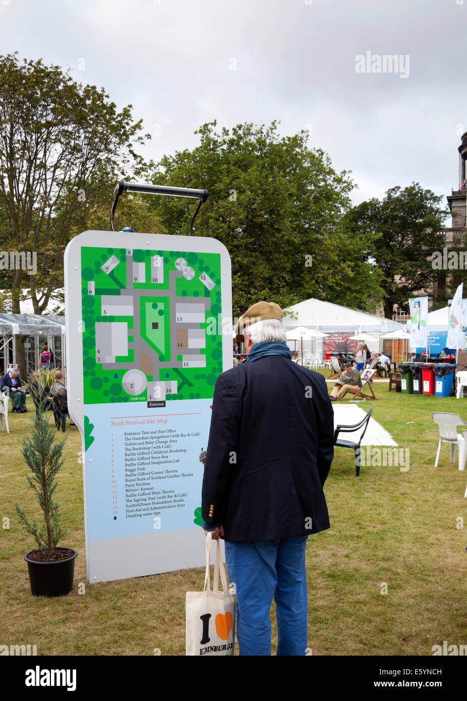 Edinburgh, Scotland, UK, 9th August 2014, opening day of Edinburgh Book Festival, Charlotte Square. Visitors relax - Stock Image