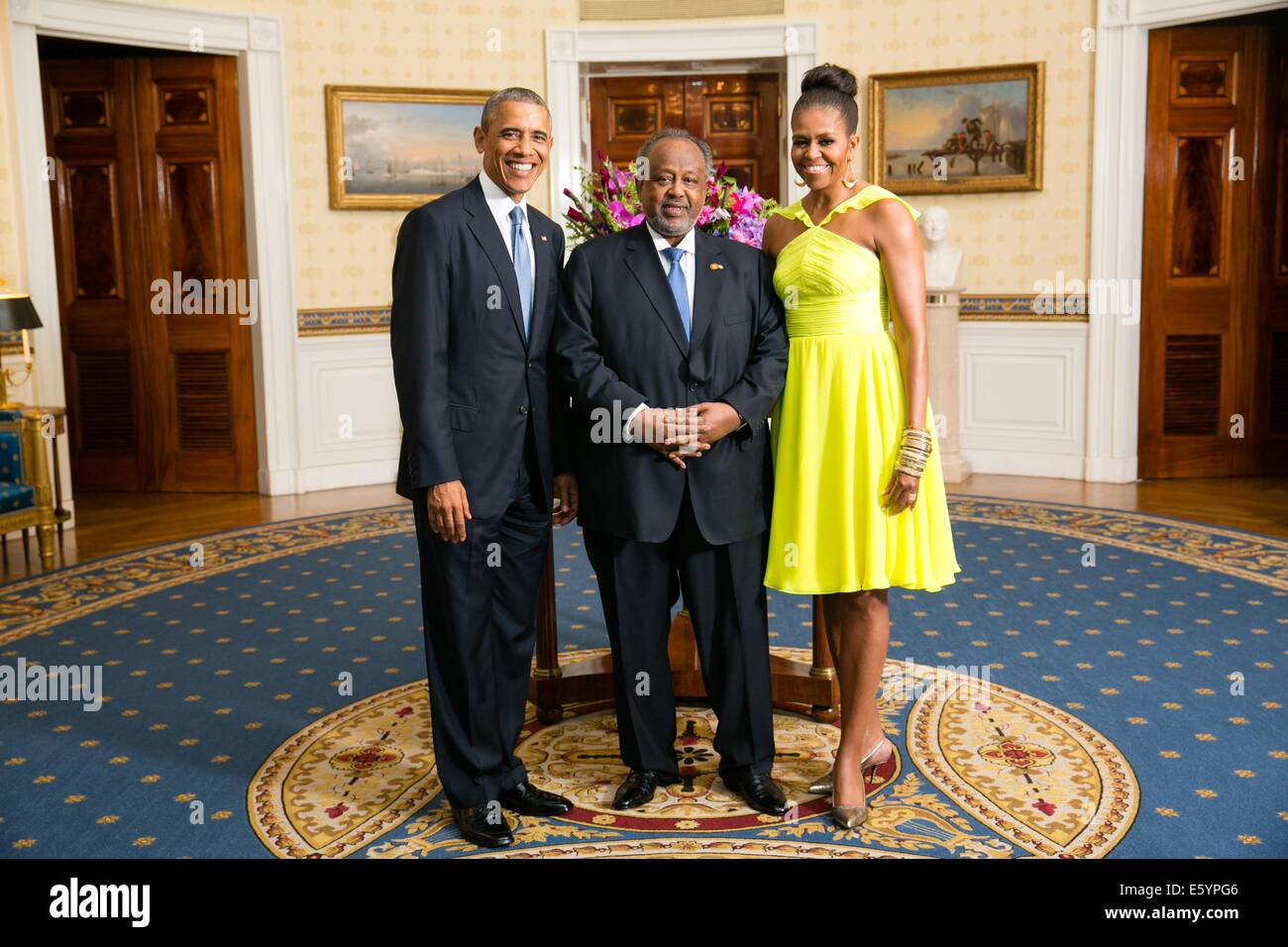 US President Barack Obama and First Lady Michelle Obama pose with Ismail Omar Guelleh, President of the Republic - Stock Image