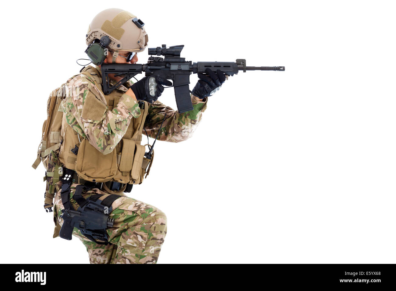 Soldier holding  rifle or sniper and ready to shot - Stock Image