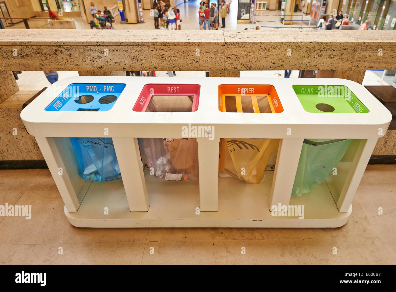 BRUSSELS, BELGIUM - JULY 17, 2014: Four color trash cans ,garbage bin, in central railway station in Brussels on - Stock Image