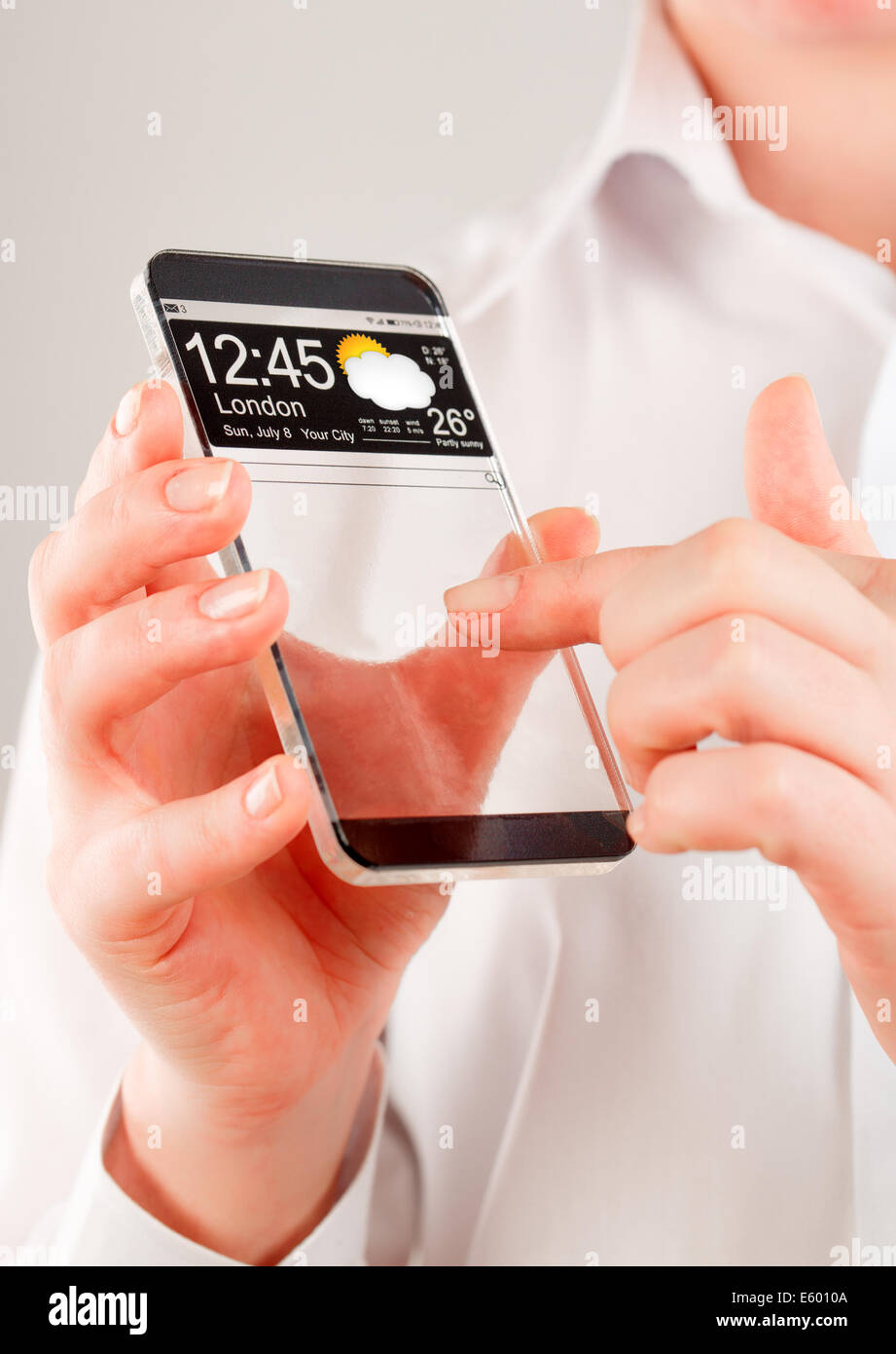 Futuristic Smart phone (phablet) with a transparent display in human hands. Concept actual future innovative ideas - Stock Image