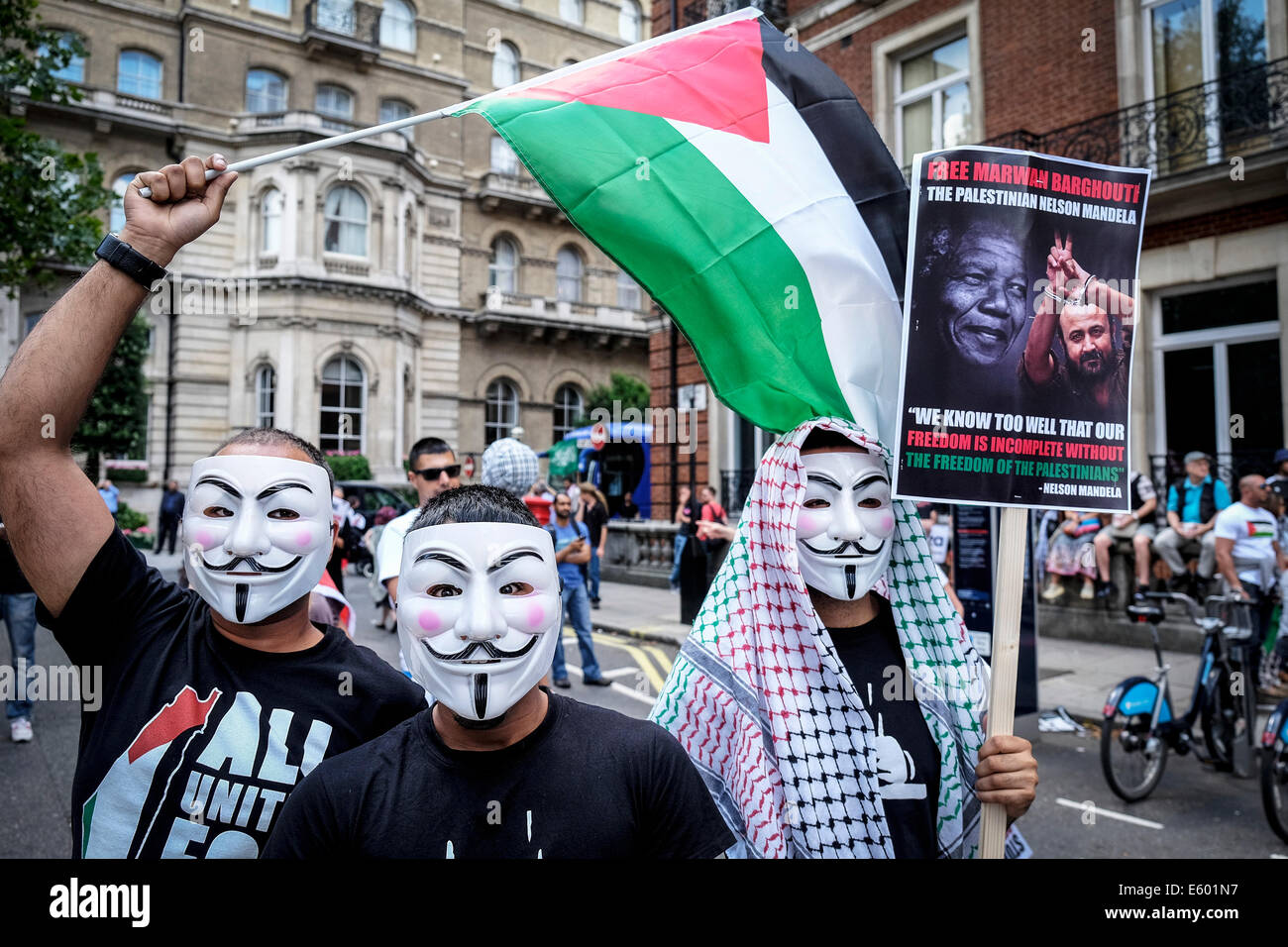 Portland Place, London, 9th August 2014. Masked Palestinian protesters at a demonstration in support of Gaza.   - Stock Image