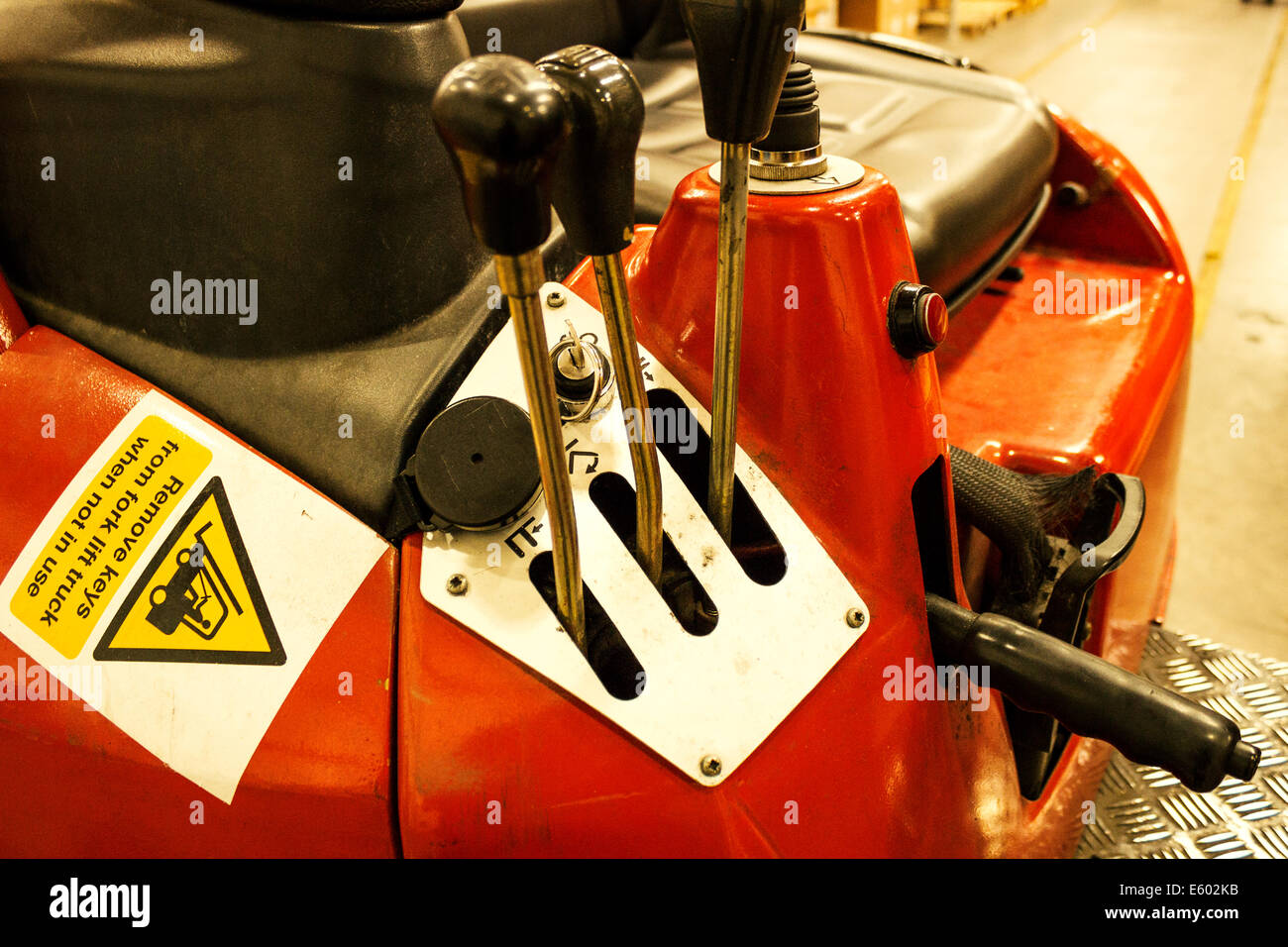 Worn warehouse forklift close up of control levers and seating area. - Stock Image