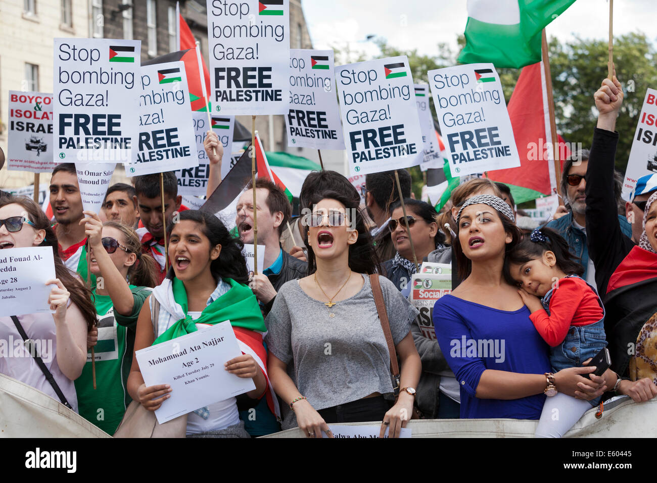 Pro Palestinian demonstrators march through the city of Edinburgh, Scotland, UK. 9th August 2014 - Stock Image