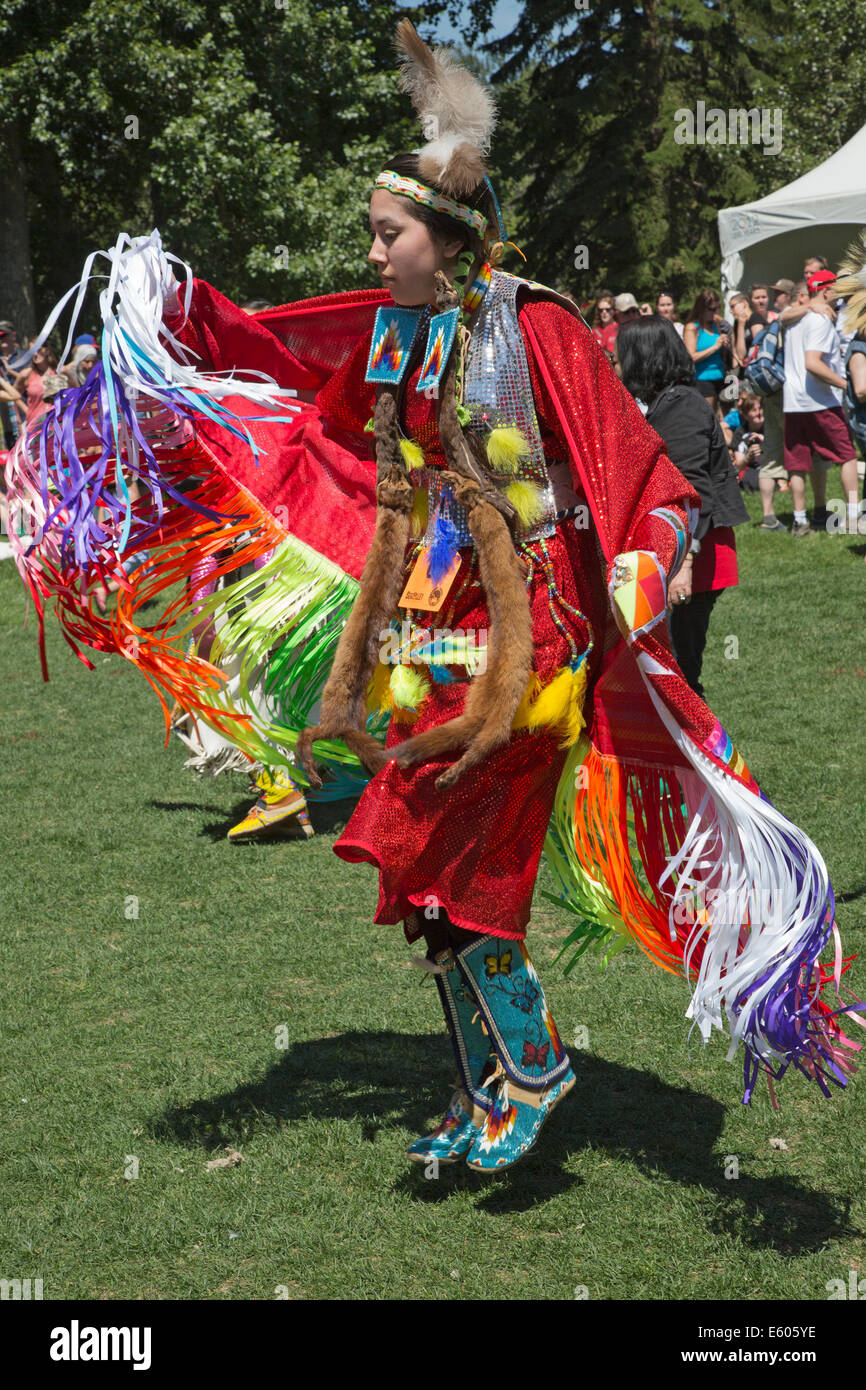 Woman dancing at First Nations powwow on Canada Day - Stock Image