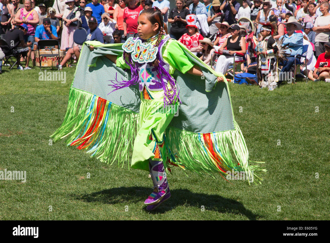 Girl dancing at First Nations powwow on Canada Day - Stock Image