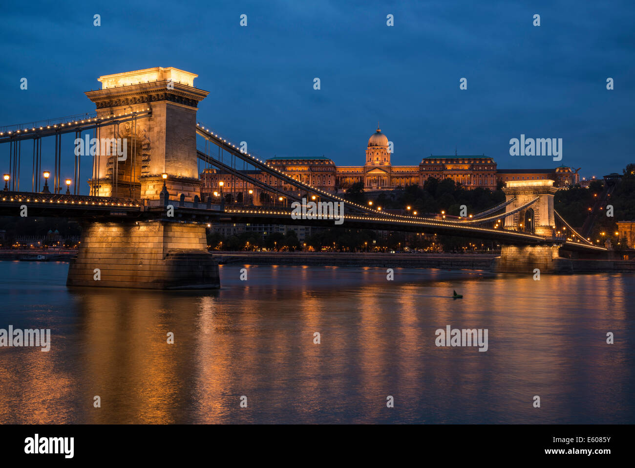 Budavári Palota - Budapest castle sits on hill above Széchenyi lánchíd Chain Bridge and Danube river at night, Budapest, Stock Photo