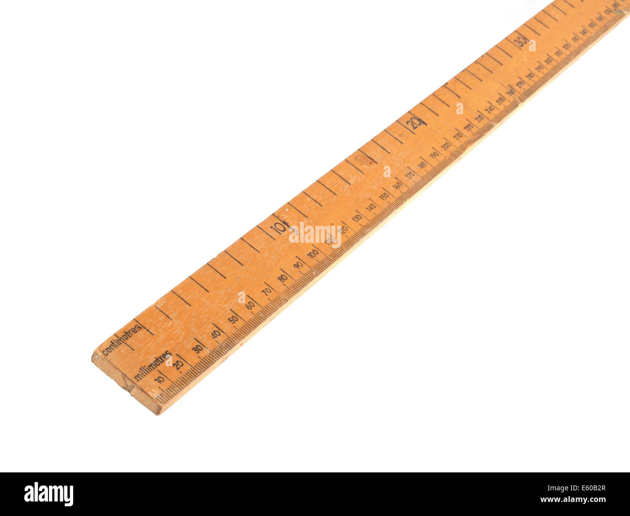Close up photo of a wooden metric ruler on a white background. - Stock Image