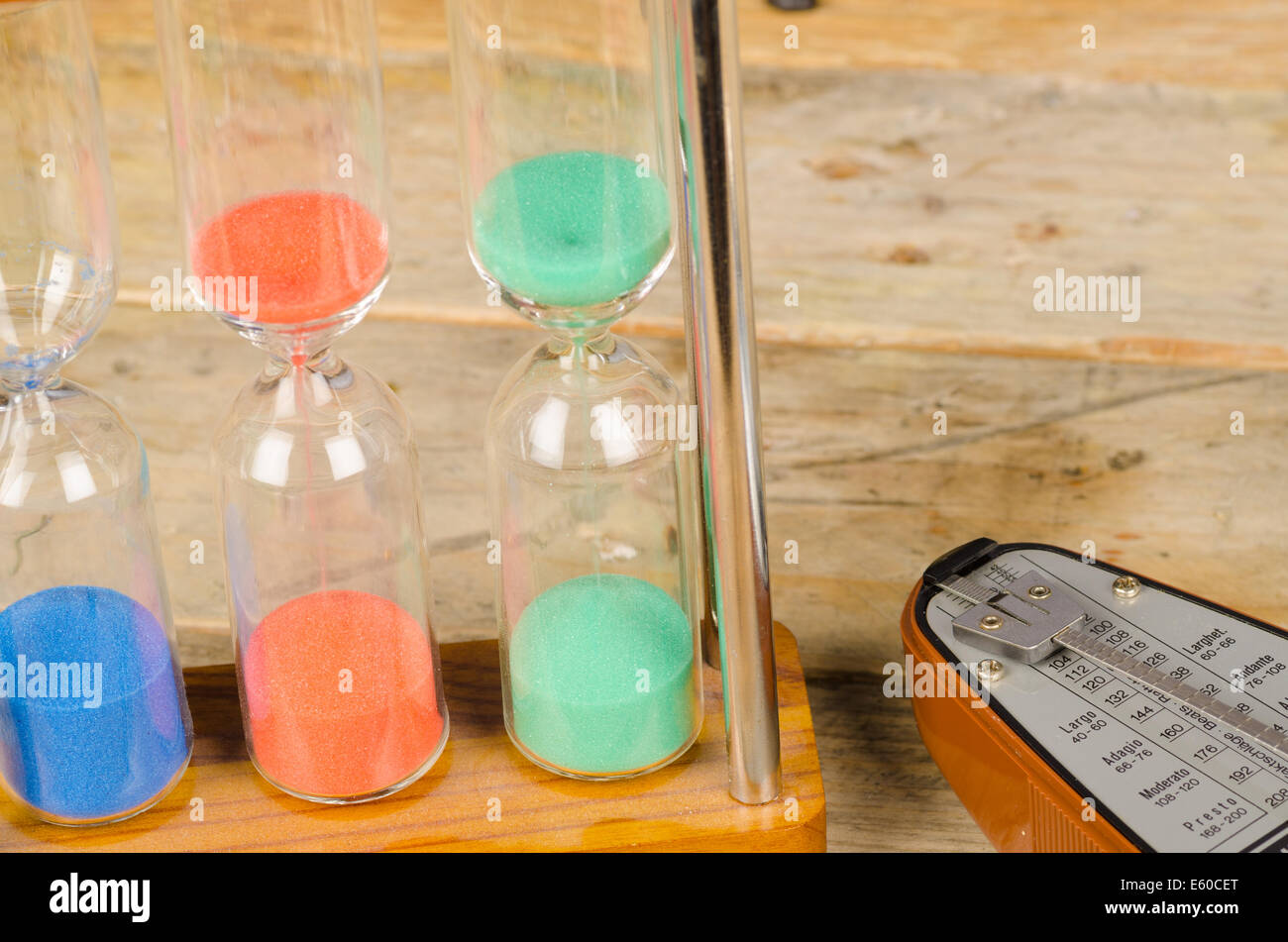 An hourglass and a metronome, a time concept - Stock Image