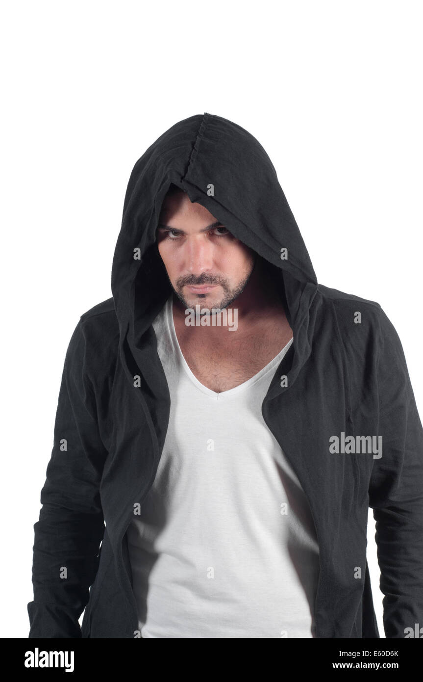 Portrait of a young angry male in the hood - Stock Image