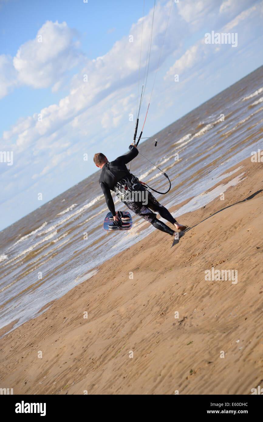 Man walking towards the sea Hunstanton , Norfolk, UK, England - Stock Image