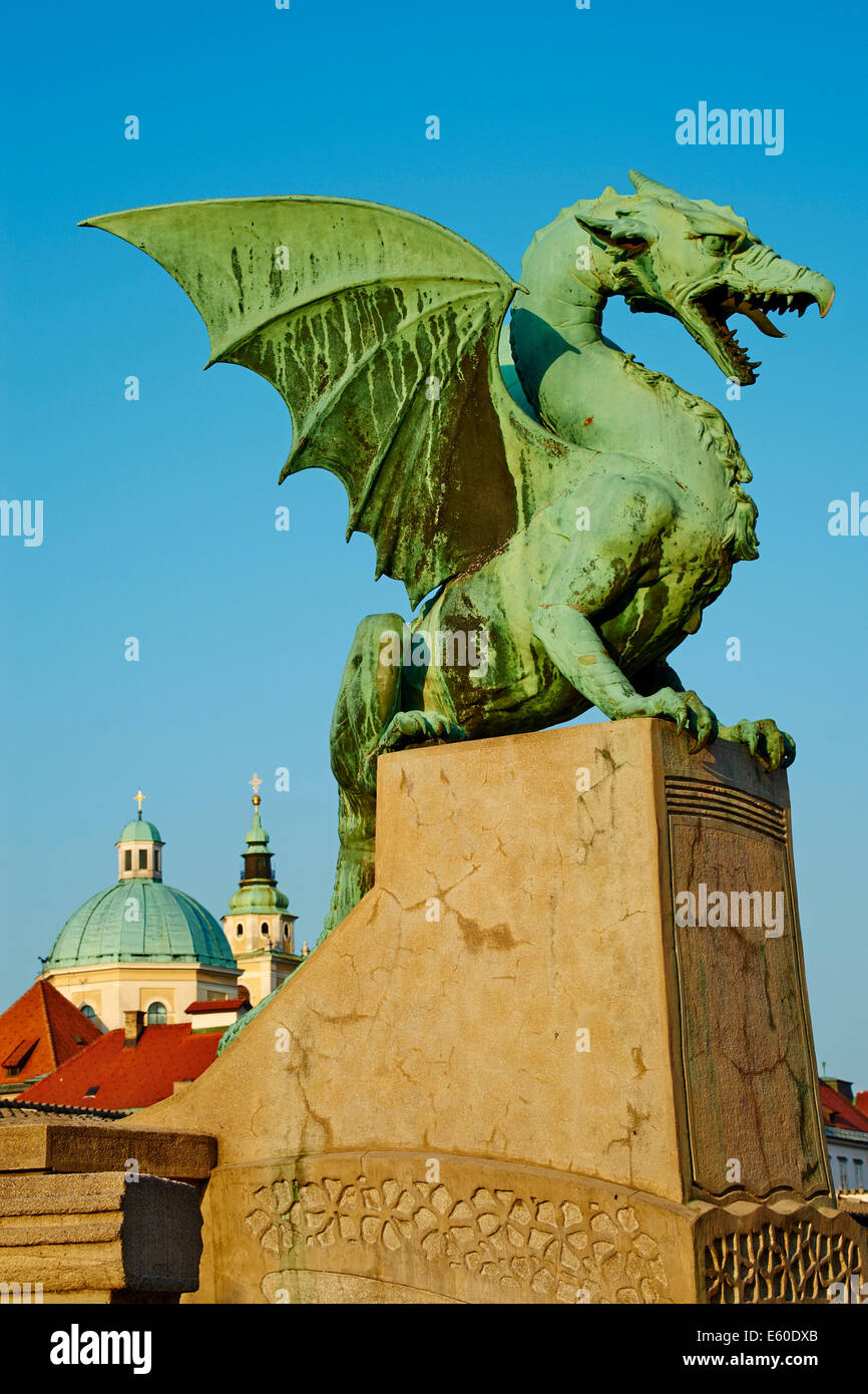 Slovenia, Ljubljana, Dragon Bridge and St Nicholas church - Stock Image