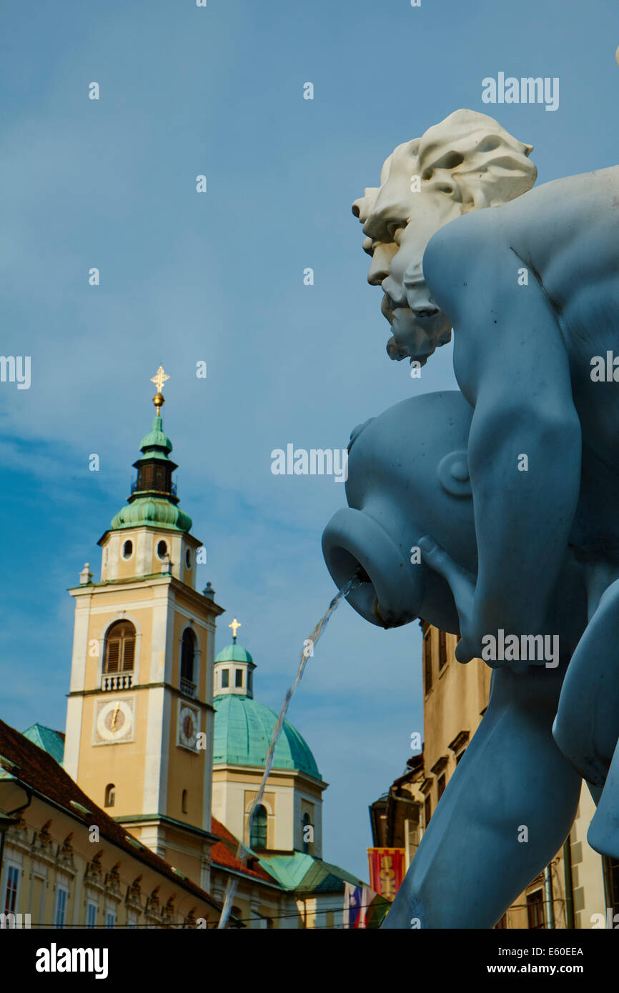 Slovenia, Ljubljana, Robba Fountain and St Nicholas church - Stock Image