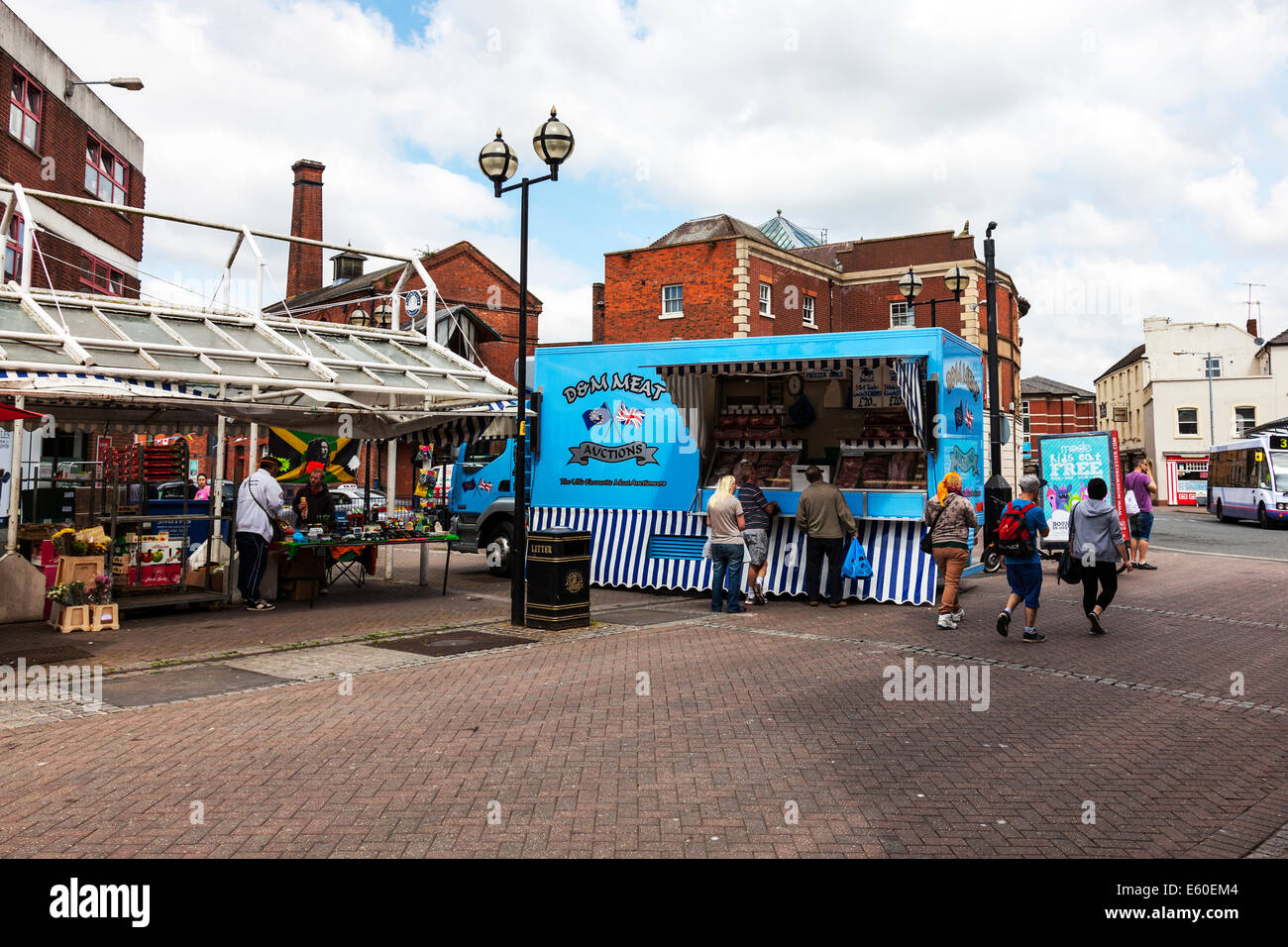 Market meat seller butcher selling meat from van lorry truck customers buying Worcester market UK England - Stock Image