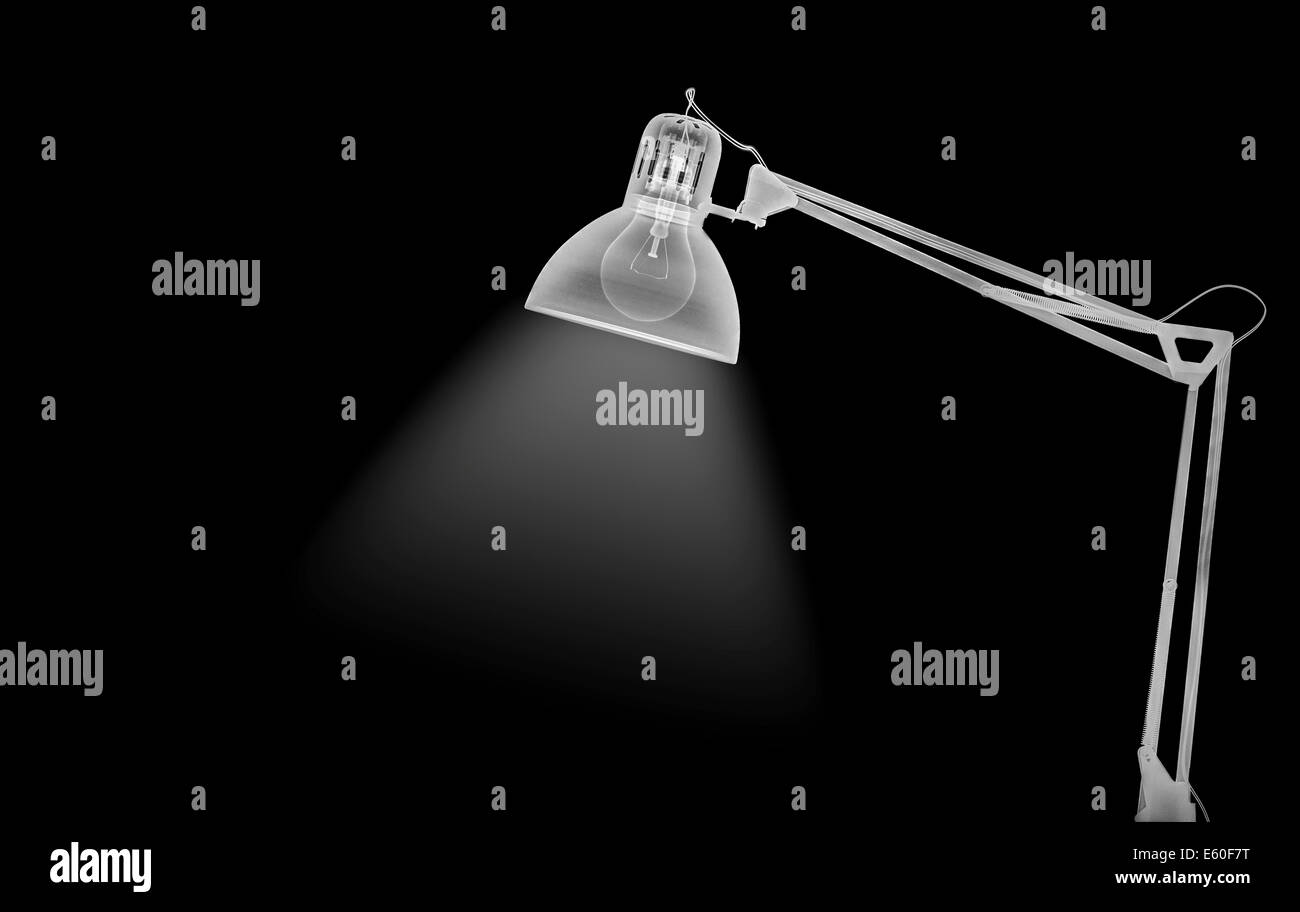X-ray of a lamp incandescent light bulb, the filament is visible - Stock Image