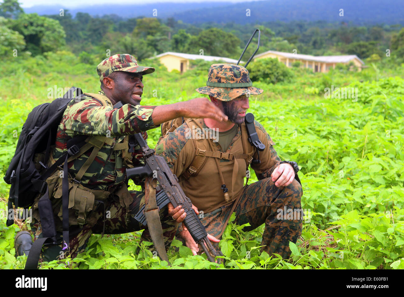 A Cameroonian soldier relays his situation to a US Marine adviser assigned to Africa Partnership Station 13, during - Stock Image