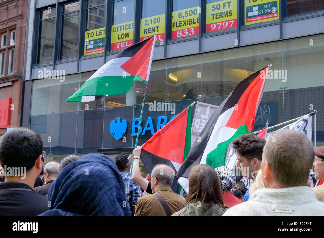 Manchester, UK. 9th August 2014. Hundreds of Pro-Palestinian demonstrators protest outside Barclays Bank in Market - Stock Image