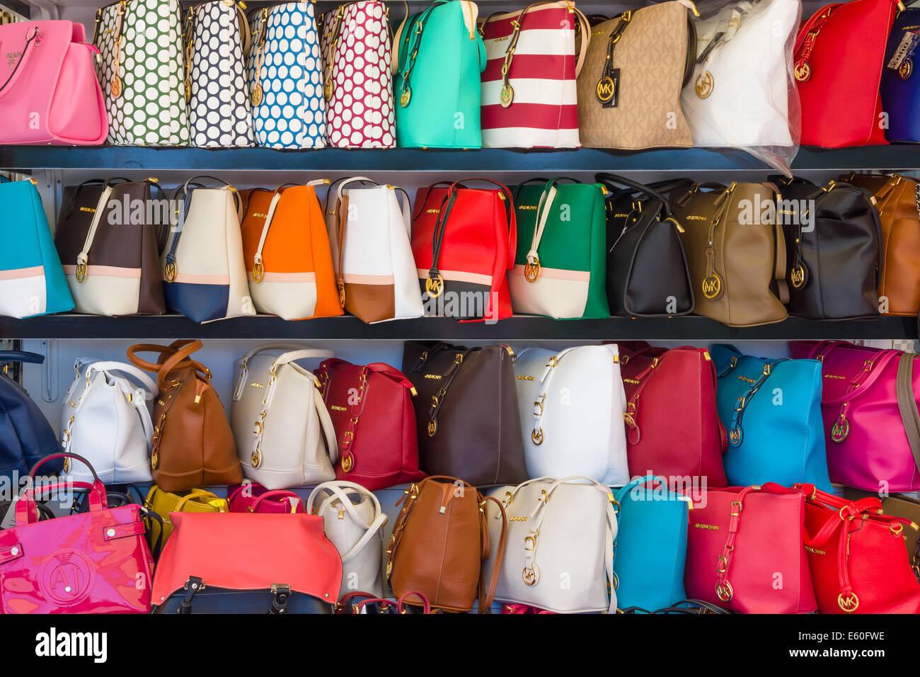 f95af2b3b673 AVSALLAR, TURKEY - JUNE 20, 2014: Showcase with fake handbags of famous  American