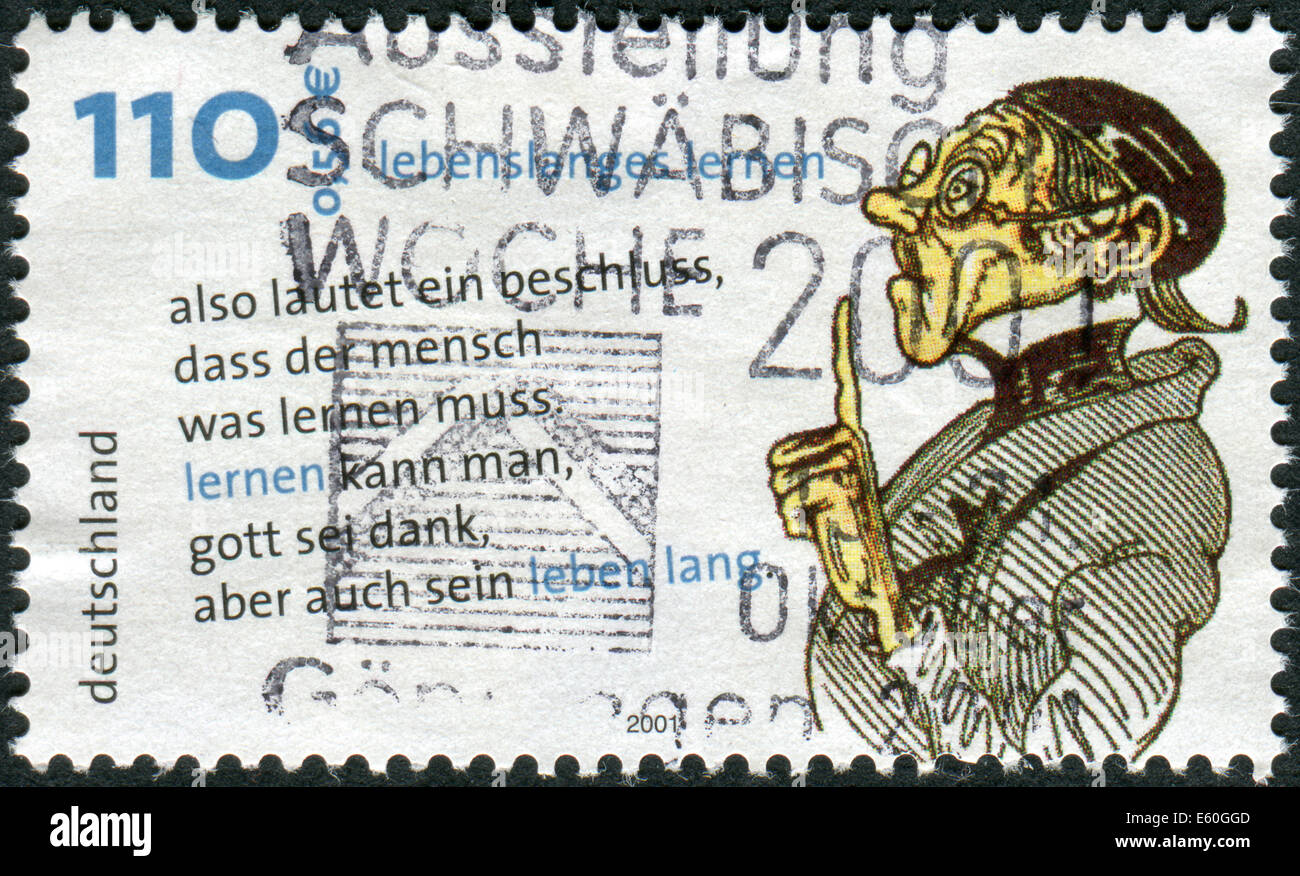 Postage stamp printed in Germany, Lifelong Learning, shows Lehrer Laempel, drawing and quotes by Wilhelm Busch Stock Photo