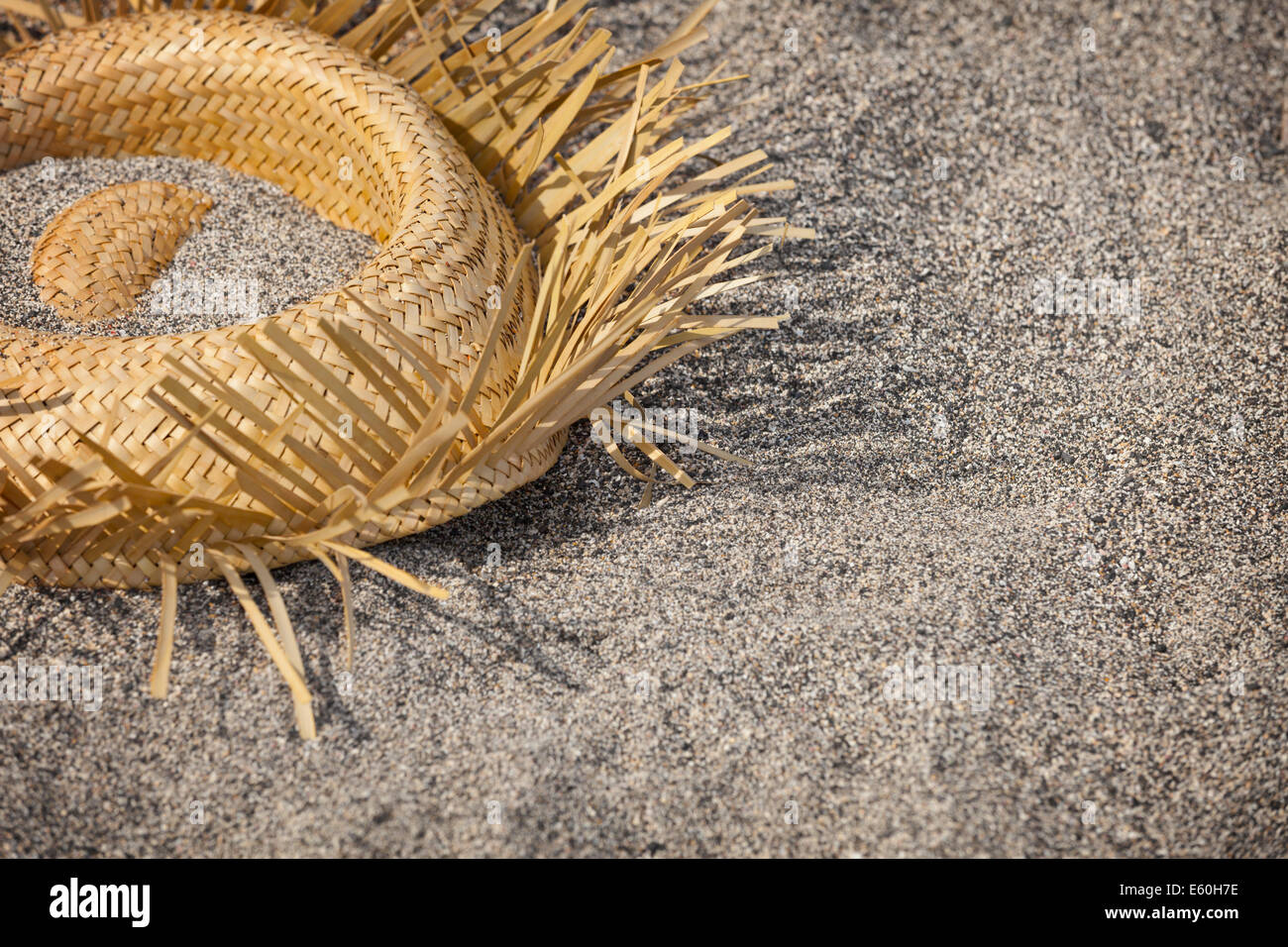 Tourists went home. Hat lying on the beach - garbage - Stock Image