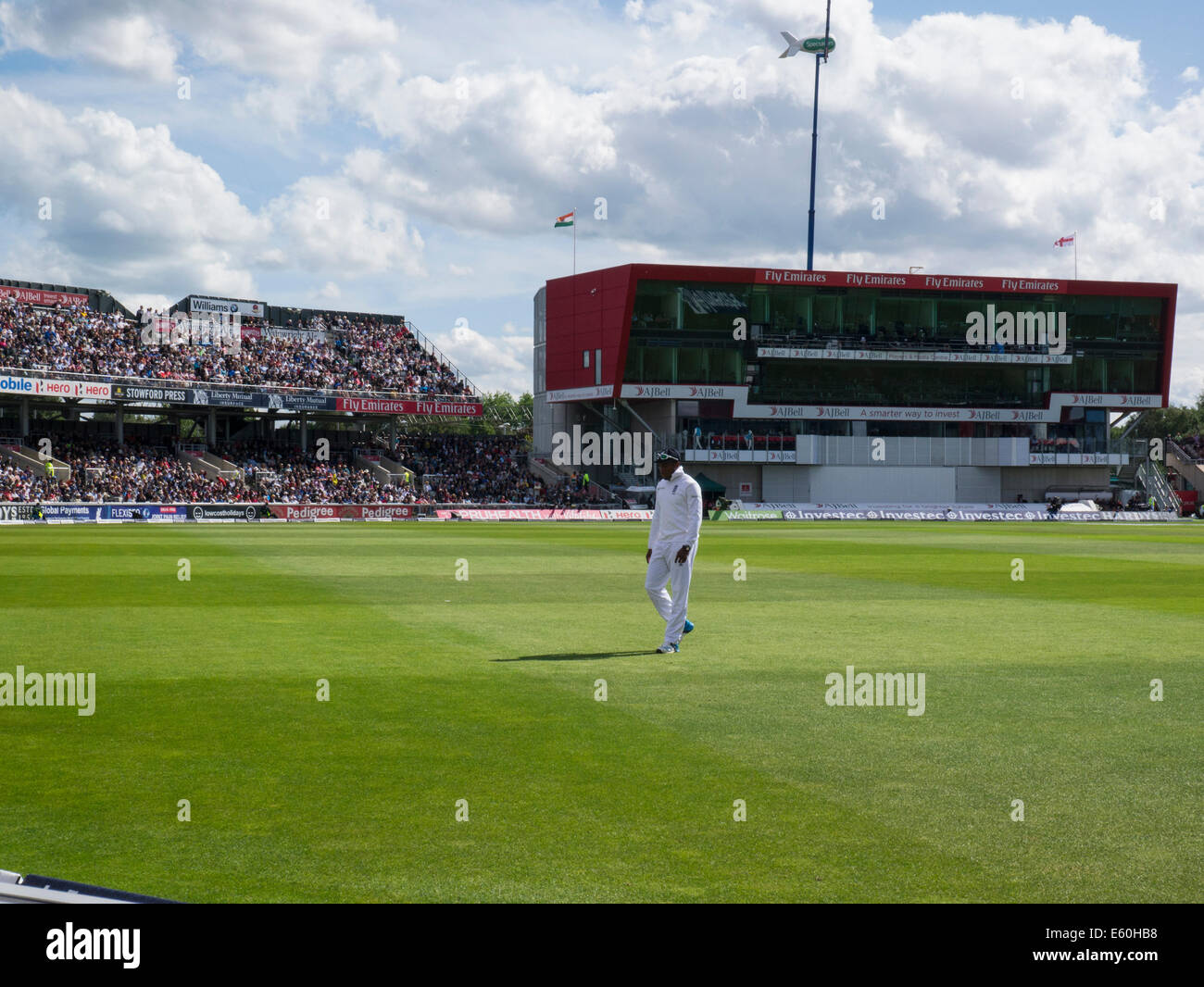 Manchester, UK.Chris Jordan walking to fielding position in 4th Cricket test win against India Old Trafford Lancashire - Stock Image