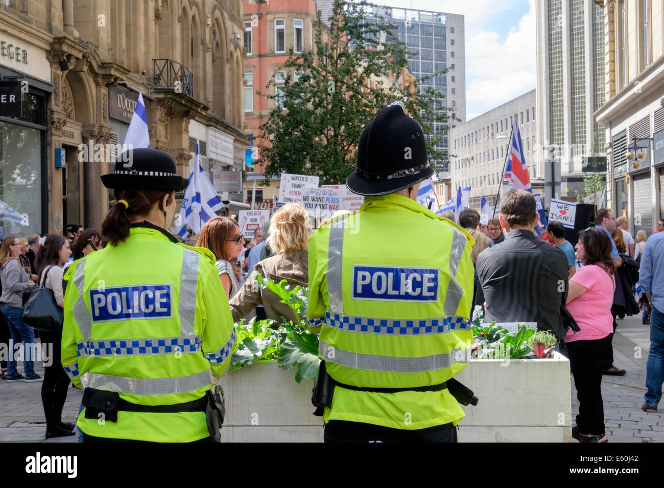 Manchester, England, UK, 9th August 2014. Two Police Officers observe the pro-Israeli and Antisemitism demonstrators - Stock Image