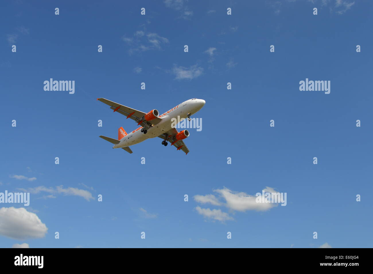 Jet landing at Manchester Airport - Stock Image