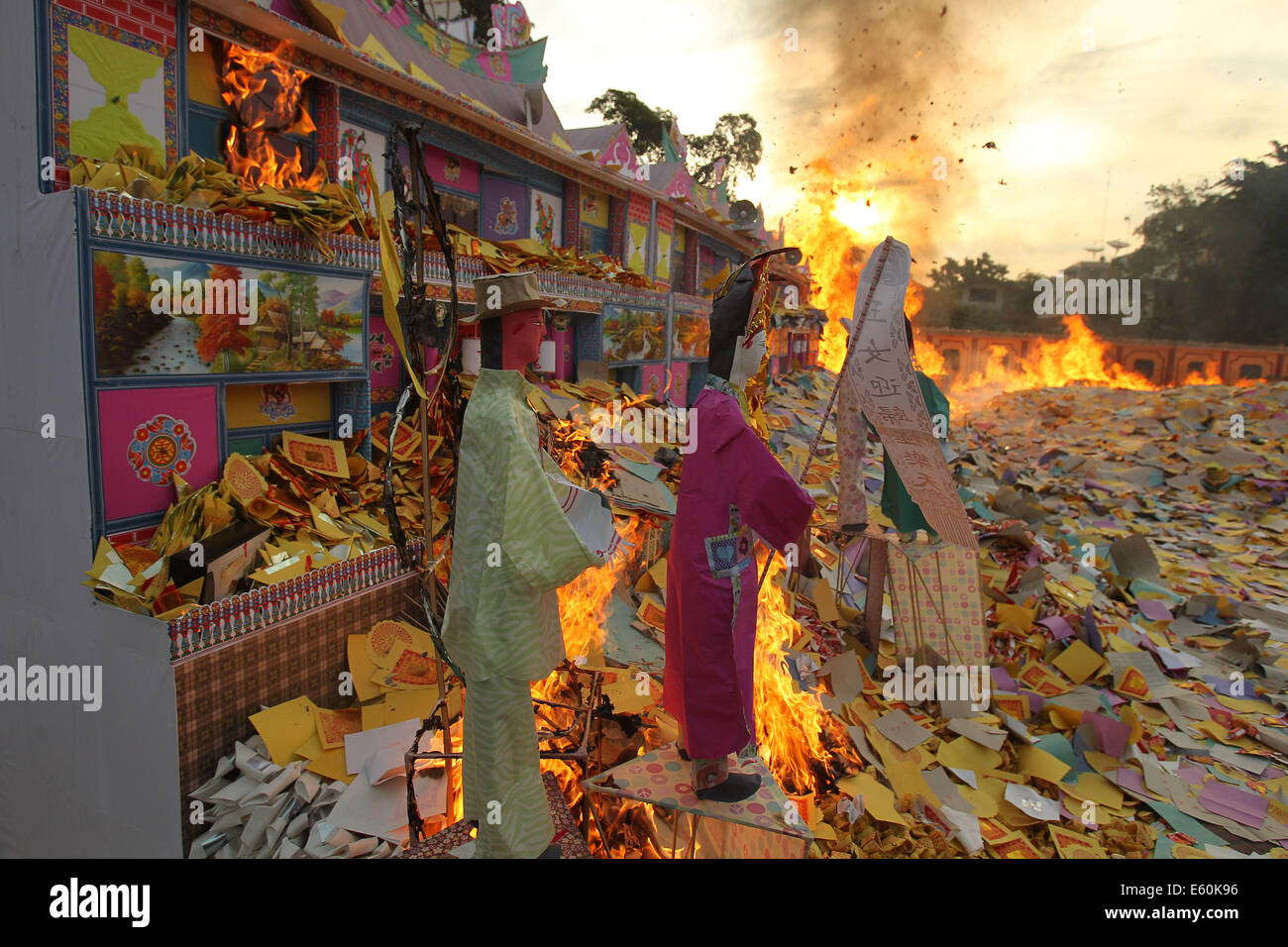 Medan, Indonesia. 10th Aug, 2014. Incense paper is burnt to honor people's ancestors during the Hungry Ghost Festival Stock Photo
