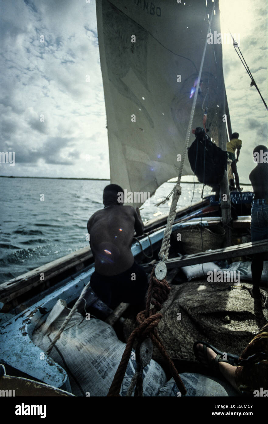 Sailing on a traditional dhow boat off the East African near Lamu - Stock Image