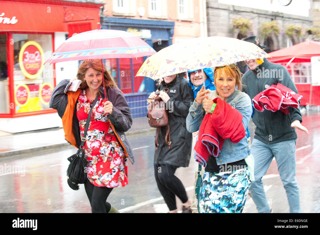 Brecon, Powys, Wales, UK. 10th August 2014. Festival goers are not disheartened by the rain which hits Brecon on - Stock Image