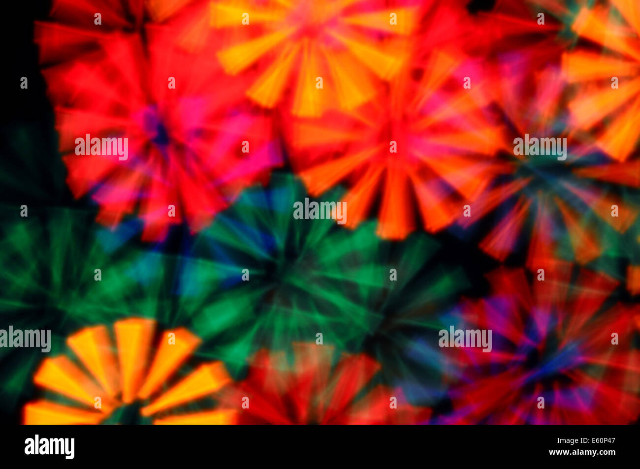 Colorful light rays abstract blurry circles psychedelic background. Stock Photo