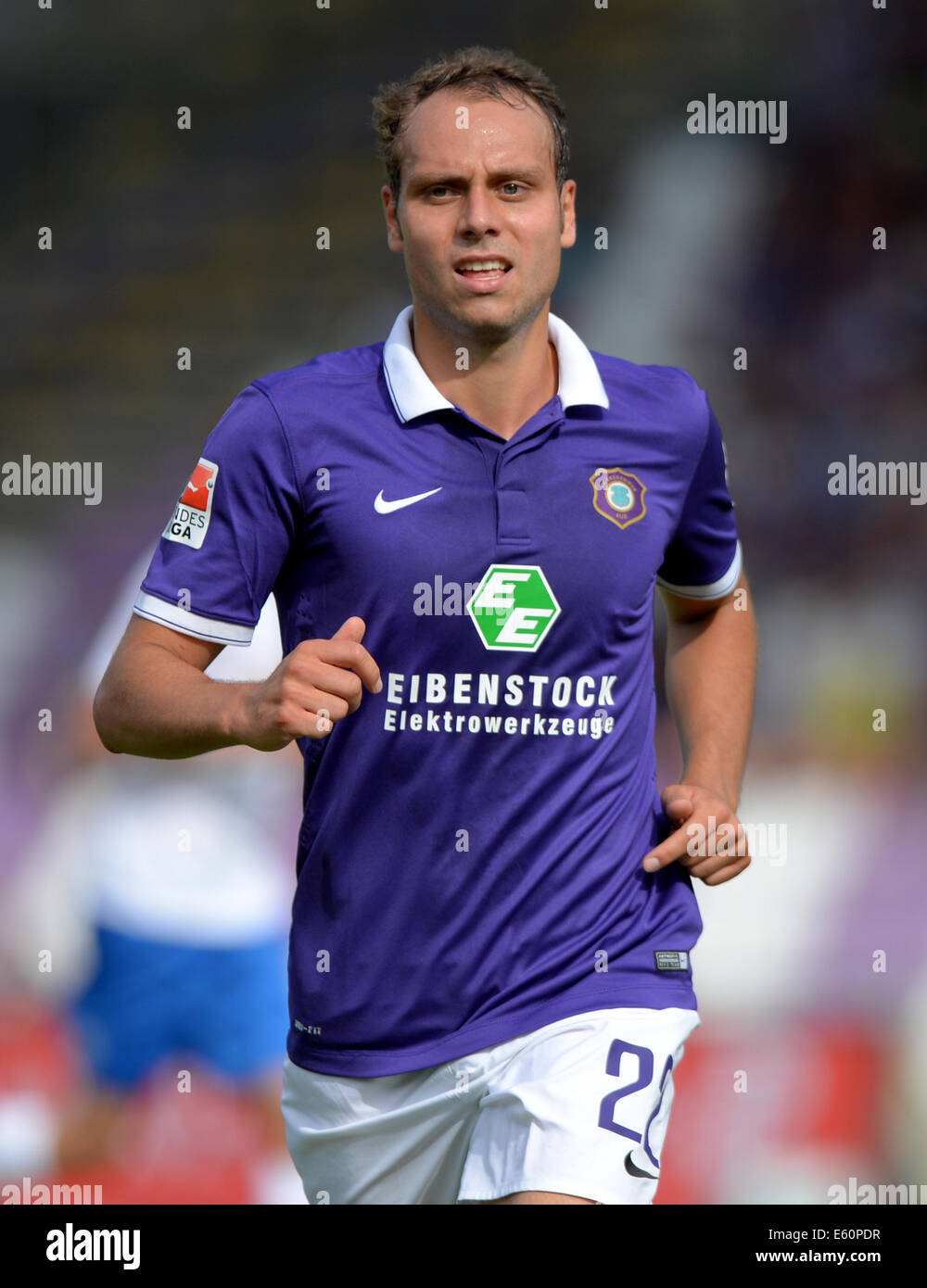 Aue, Germany. 09th Aug, 2014. Aue's Rico Benatelli during the German second league soccer match between Erzgebirge - Stock Image