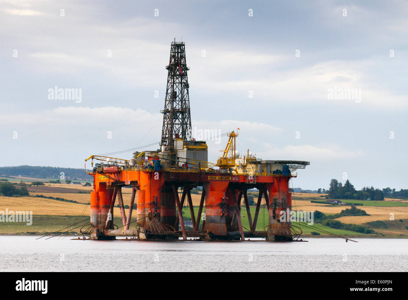 Invergordon, Scotland, UK. The Ocean Vanguard Semisub Oil rig and service vessels have lined up in the Cromarty - Stock Image