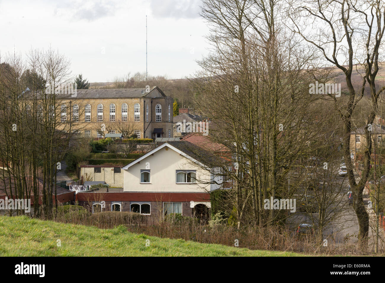 The former 19th century Barrow Bridge Institute (now apartment flats), lies beyond 20th century housing  in north - Stock Image