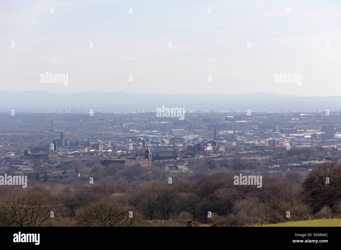 Hazy landscape of Bolton, Lancashire from Scout Road on the hills to the north of Bolton. - Stock Image