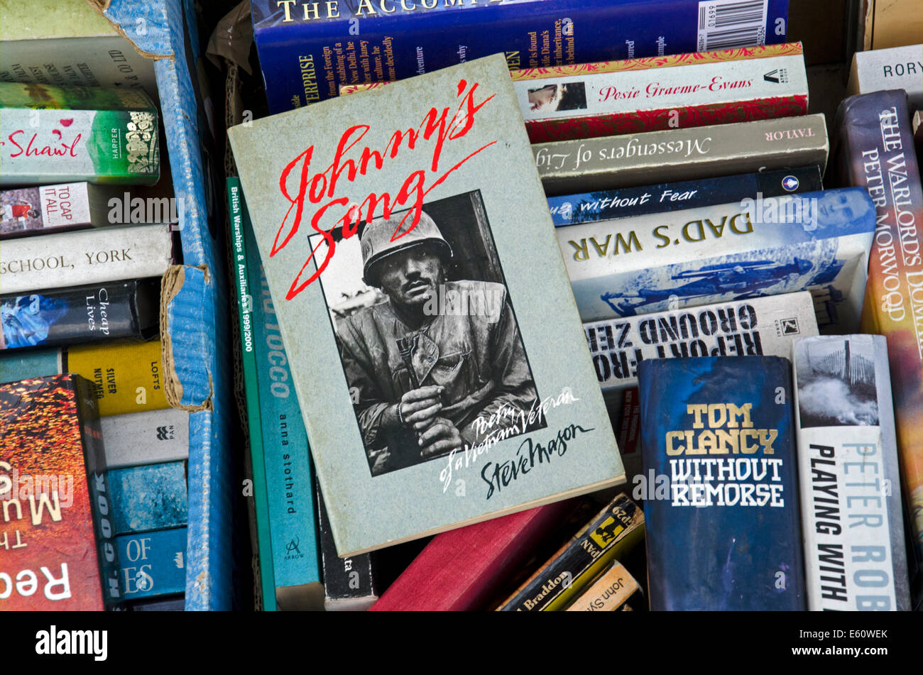 'Johnny's Song' by Steve Mason in a box of books outside a secondhand bookshop in Edinburgh. - Stock Image