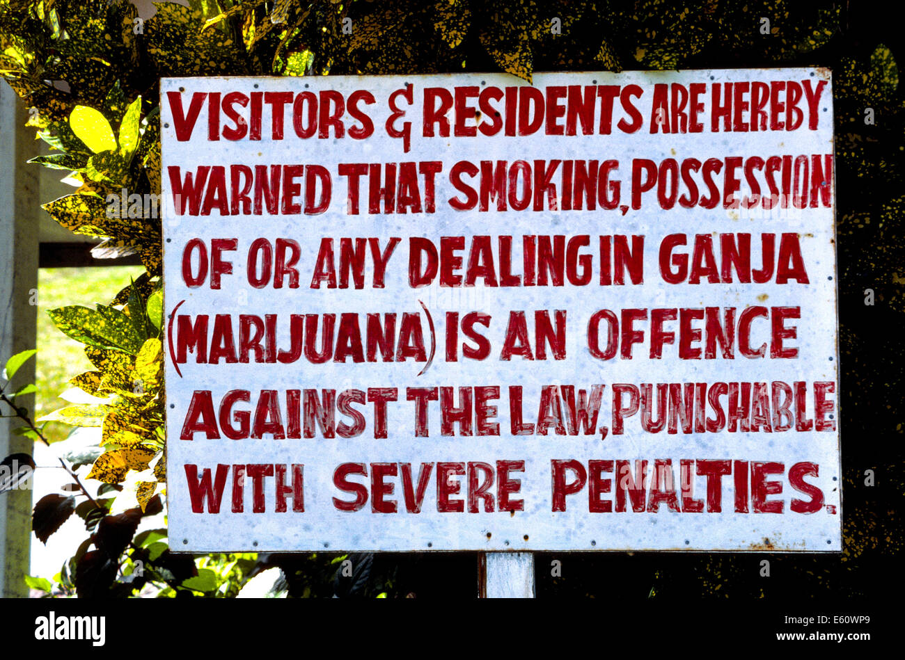 A now outdated sign warns against the possession of ganja in Jamaica, a popular vacation island in Caribbean where - Stock Image