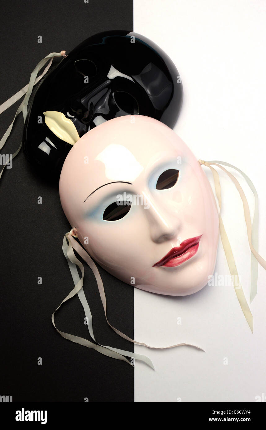 Black and white theme ceramic masks for acting, performance or theater concept. Vertical. - Stock Image