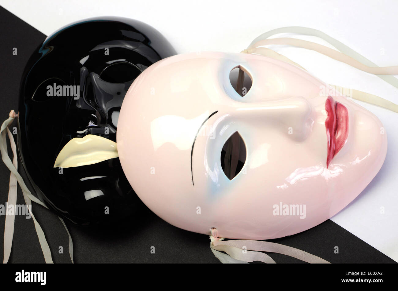 Black and white theme ceramic masks for acting, performance or theater concept. Close up. - Stock Image