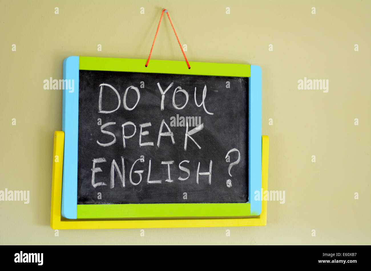 Do you speak english? Handwritten with white chalk on a blackboard.concept photo of learning and teaching English Stock Photo