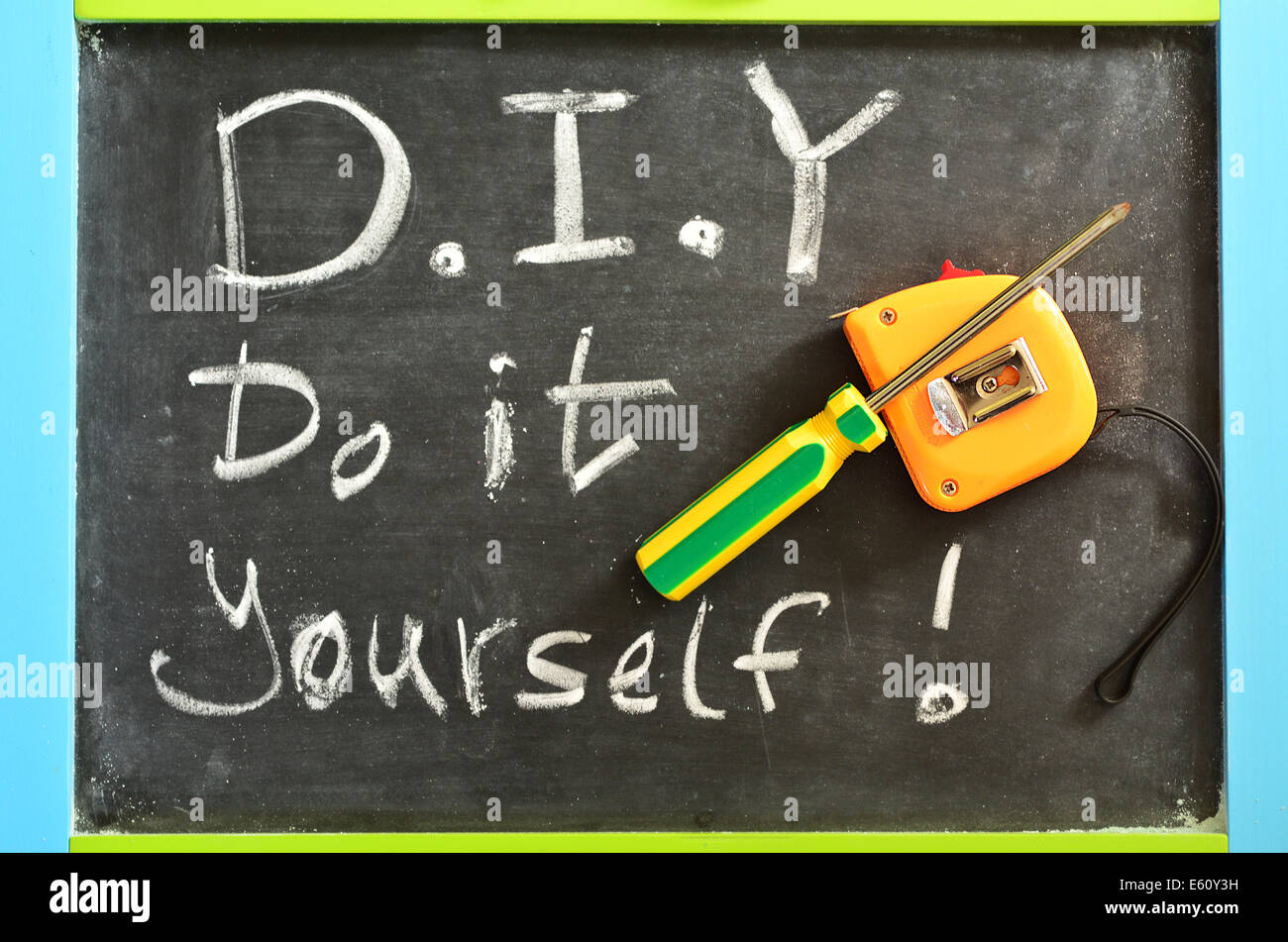 Do It Yourself - D.I.Y , Handwritten with white chalk on a blackboard with working tools.concept photo of Do It - Stock Image