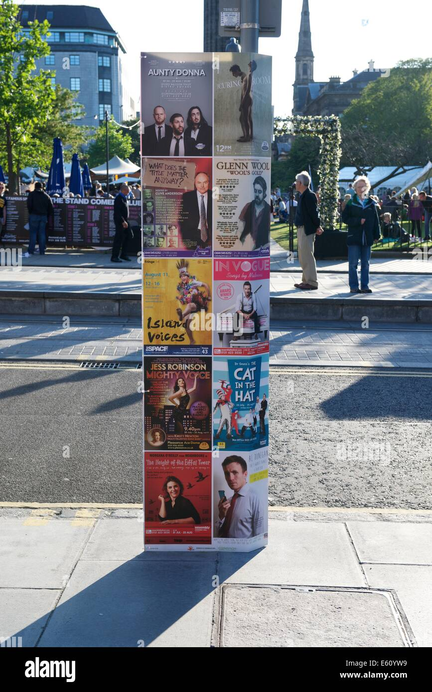 Posters advertising Edinburgh Fringe Festival performances attached to street furniture in St. Andrew's Square. - Stock Image