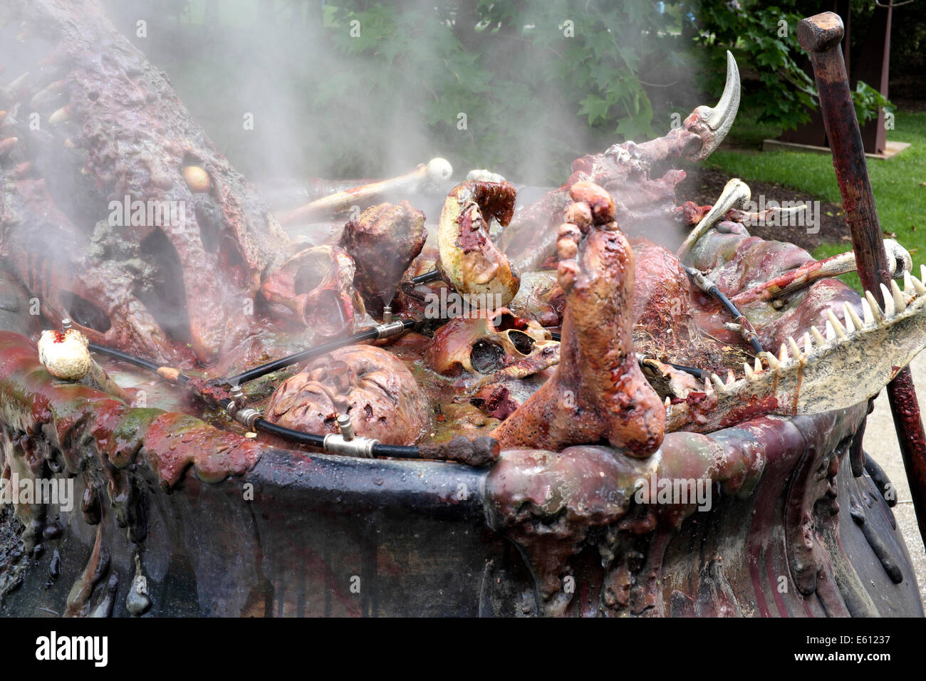 Closeup of pot of boiling body parts - part of Three Fates Sculpture at the NJ Grounds for Sculpture - Stock Image
